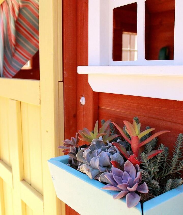 Bright and colorful succulents brighten up this little playhouse! #AugustGarden