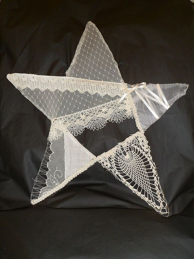 I fashioned a star out of barbed wire then sewed on scraps of lace, ribbon and doilies..very happy with the outcome