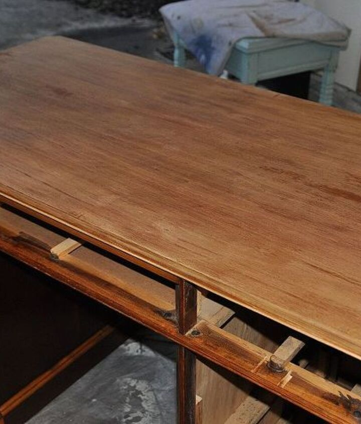 My client wanted a dark Kona color stain on the top, so I used stripper and sanded it down smooth.