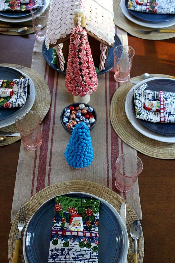 candy land christmas tablescape, christmas decorations, crafts, seasonal holiday decor, Blue plates from a local potter is the beginning point of this tablescape