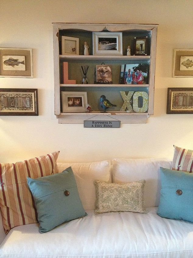 I painted the back of the shelf.  Added white frames...love them...New Blue/aqua pillows.