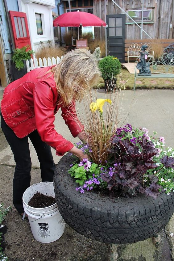 Step 6:  Fill in with soil between the newly transplanted pots and water  in generously.