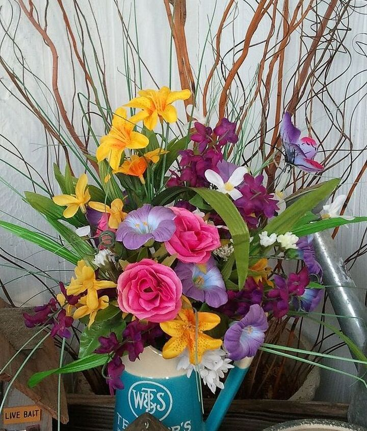 Spring/summer flower arrangement. The pitcher is an old liquor decanter given to me. I love it !