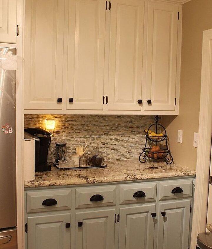 Great new cabinet colors, hardware, granite and tile backsplash!