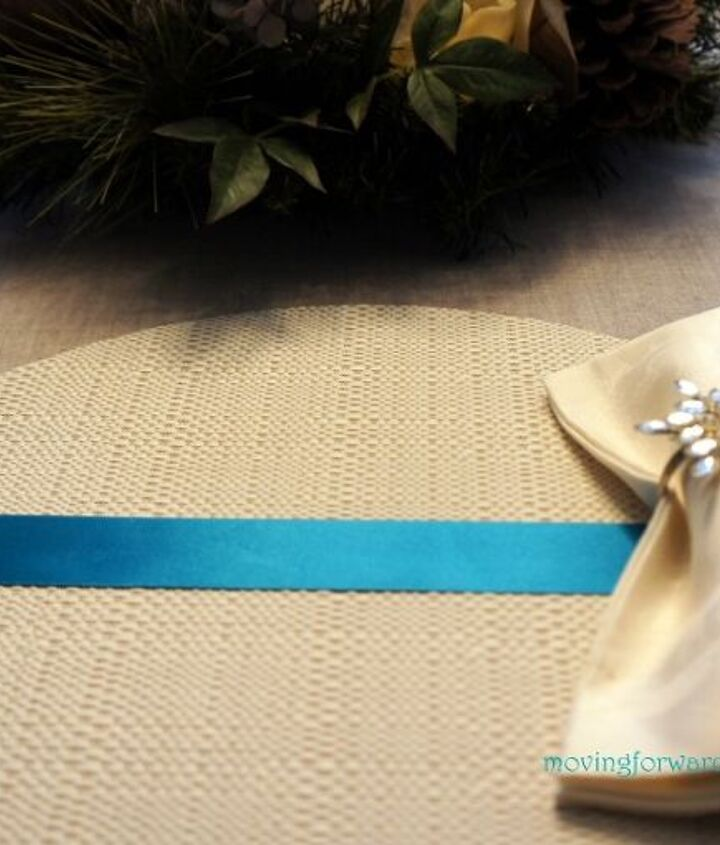 Inexpensive vinyl placemants were embellished with ribbon and snowflakes.