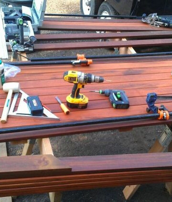 After the sanded and oiled pieces had the night to dry, I brought them outside, cut them to size, and assembled. The Ipe frame is mitered, wiped with distilled alchohol, plowed out with the Festool Domino, glued and clamped.