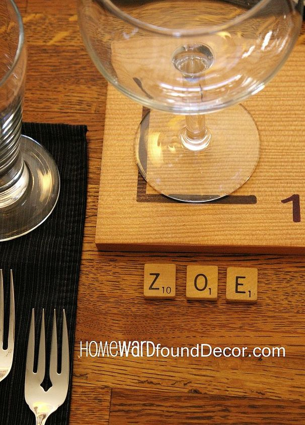 Scrabble letter tiles act as place cards, spelling out the name of each guest. A giant version of the letters is a coaster under the wine glass. (how many words can YOU make up from the letters at your seat?!)
