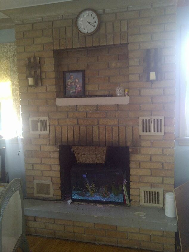 This is our fireplace, with a fishtank atm. Need advise, hate it as it is right now.