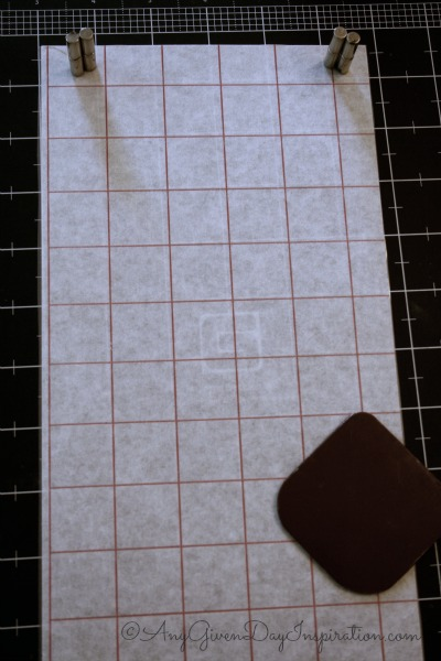 Next, apply transfer tape to design. This allows you to keep design while exposing sticky side of vinyl.