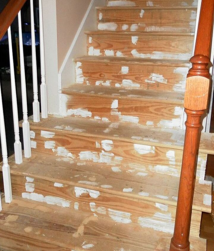 After removing the carpeting and hours spread over weeks of plucking out staples, the stairs are ready for a good sanding.