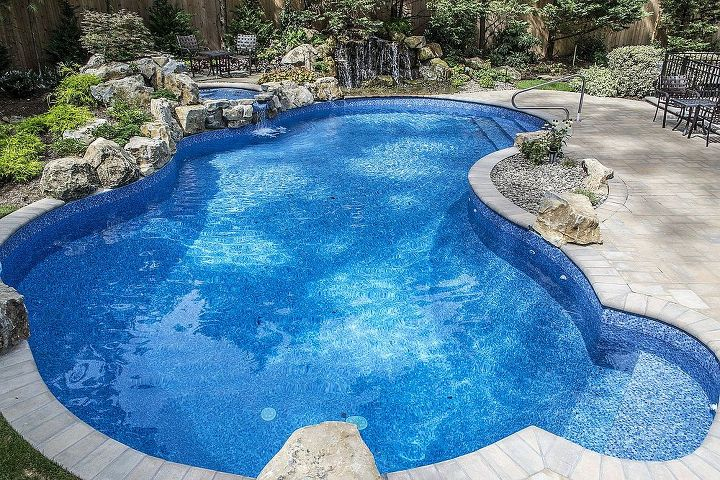 peaceful backyard how to solve outdoor noise problems, decks, landscape, outdoor living, ponds water features, pool designs, spas, Vinyl Freeform Pool New pool has a deep end swim out swim out stairs at opposite end diving rock natural boulder accents handsome coping and a raised spill over spa