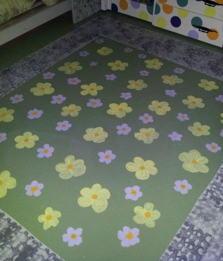 """Due to allergies, all the floors in the house are painted concrete. She has a """"stone path"""" surrounding her room and a field of flowers."""