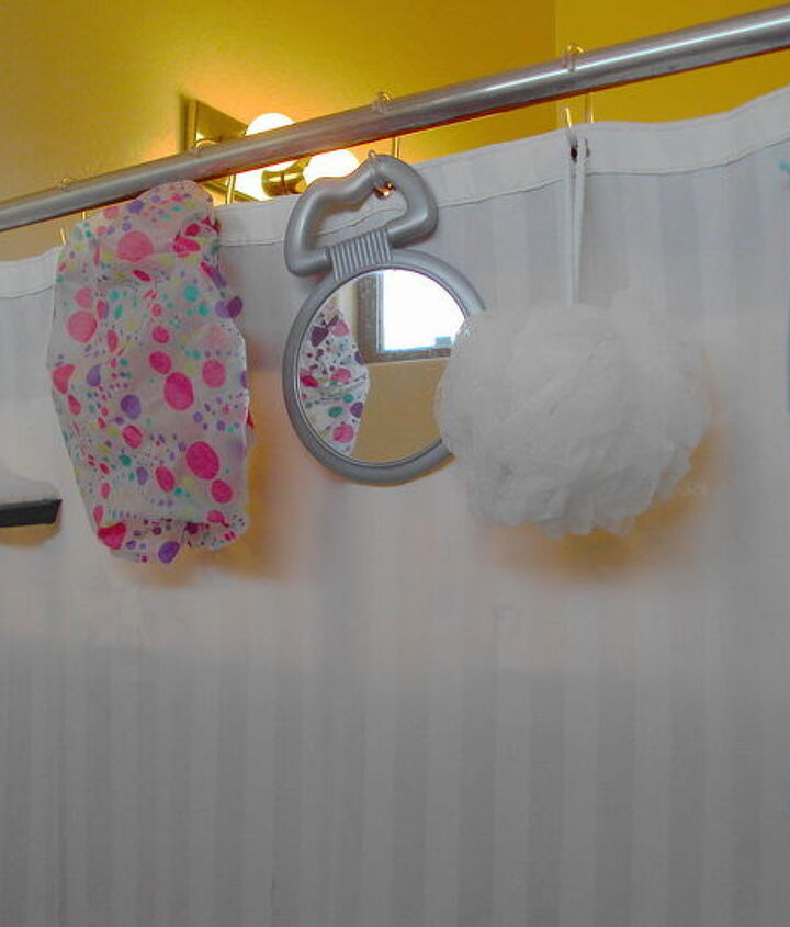 Inexpensive C style shower hooks for storing shower supplies.
