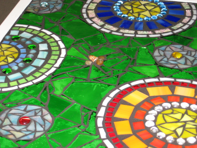 stained glass mosaic patio table, painted furniture, tiling, After finishing The Weldbond glue will dry clear but it usually takes a while and there may be a glue shadow Still it is my favorite glue to use