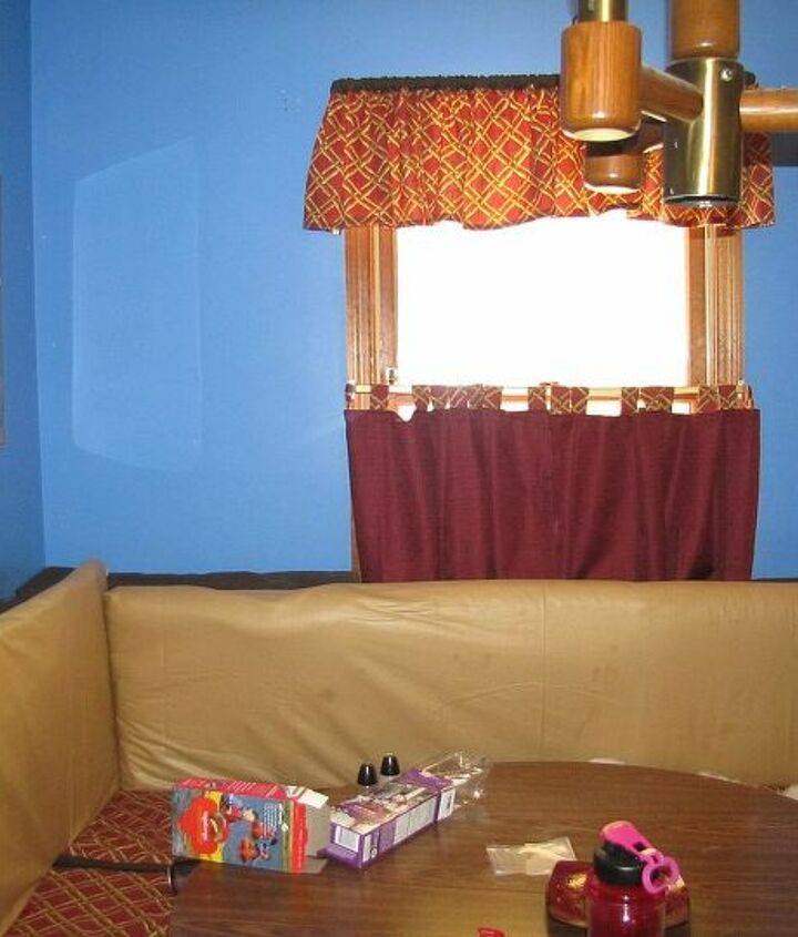 This is the room it's in, a dining room with built in banquette, red, blue, gold/tan.