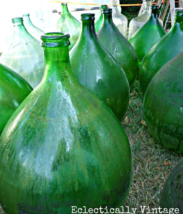 Demijohns as far as the eye could see at Brimfield! http://eclecticallyvintage.com/2012/07/fab-friday-finds-a-tale-of-brimfield/