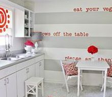 how to remodel a kitchen on a budget, home decor, home improvement, kitchen design, Here s the after with gray painted stripes on the wall and new flooring and fun simple projects