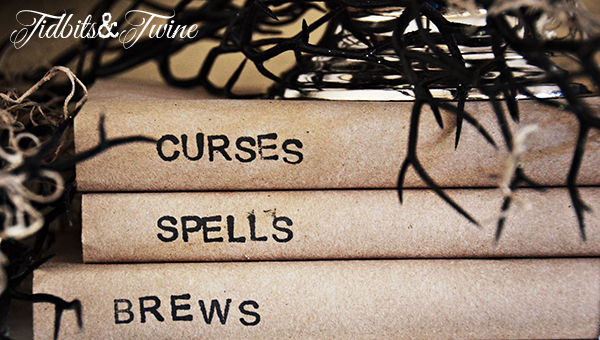 Learn how to make these kraft paper stamped books here: http://tidbitsandtwine.com/diy-stamped-kraft-covered-books/