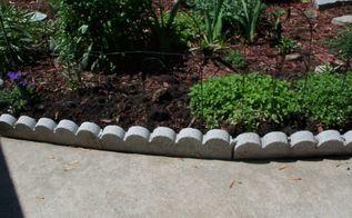 finishing touch with edging stones, concrete masonry, flowers, gardening, landscape