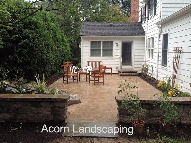 Outdoor Living Area with Pond-less Waterfall, Paver Patio, Sitting Wall, Pillars and Steps in Brighton NY by Acorn Landscaping of Rochester NY