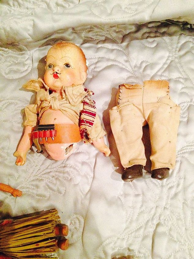 q how do you care for old dolls parts clothes, crafts, This little guy is just adorable He s got a tool belt on Someone tied his shirt up Any ideas