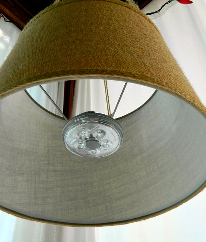 Off the grid drum shade pendant using battery-operated LED light.
