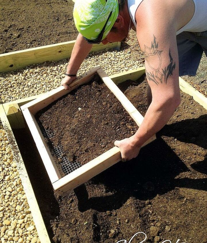 raised bed garden part 3 dirt and planting, diy, gardening, how to, raised garden beds, Sifting the dirt to get all the unwanted bits and pieces out before planting