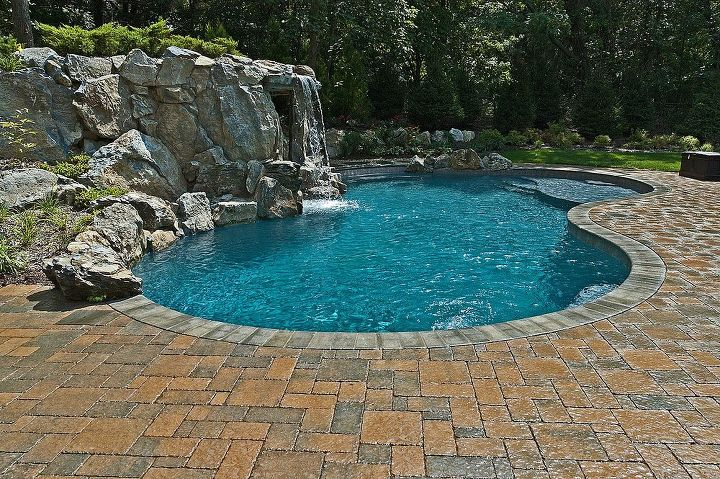 some of our best projects are a result of a referral from some one who did not use us, concrete masonry, outdoor living, pool designs, spas, Freeform concrete pool and waterfall with hidden grotto