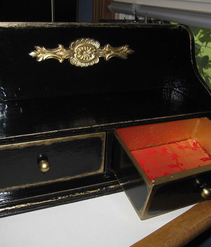 I lined the drawers with Gold Satin that has a red flower design.  I figured that the black with gold had an Asian feel and wanted to keep the inside of the drawers the same style.