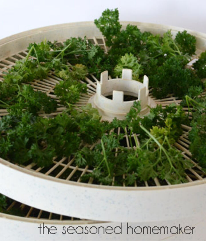 I layer my herbs onto the 4 trays and stack them according to the dehydrator's instructions.  Then, I set my dehydrator on the lowest setting (95-degrees on my model) and let it dry for 12-20 hours.  When they crumble, they are done.