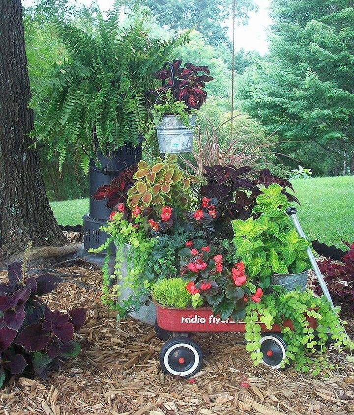 Radio flyer wagon, washtub and an old heater repurposed as a plant stand.