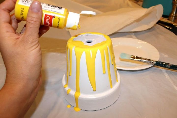 Pour paint on the edge so it drips down the sides.