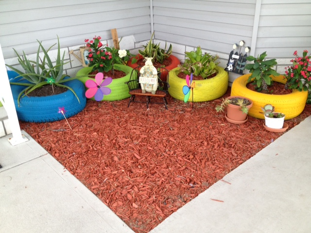 recycling old tires, gardening, repurposing upcycling, THIS IS IN A CORNER OF MY FRONT PORCH THAT DOESNT GET ANY RAIN AND VERY LITTLE SUN SO YOU GOTTA PLANT BUSHES OR TREES THAT WONT NEED MUCH OF THESE