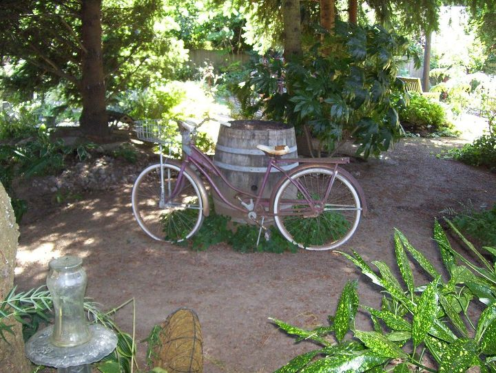 the old bicyle lays against an even older wine barrel in our park area. I will post more park pictures this week. Enjoy