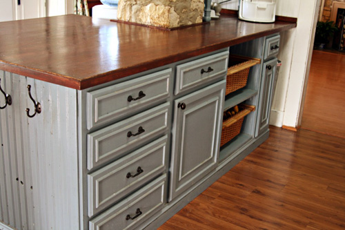 kitchen counters on a deep budget, countertops, home decor, kitchen design, kitchen island, After building the island using stock cabinets with a plywood top I screwed the long pine planks from underneath sanded and stained it Gorgeous