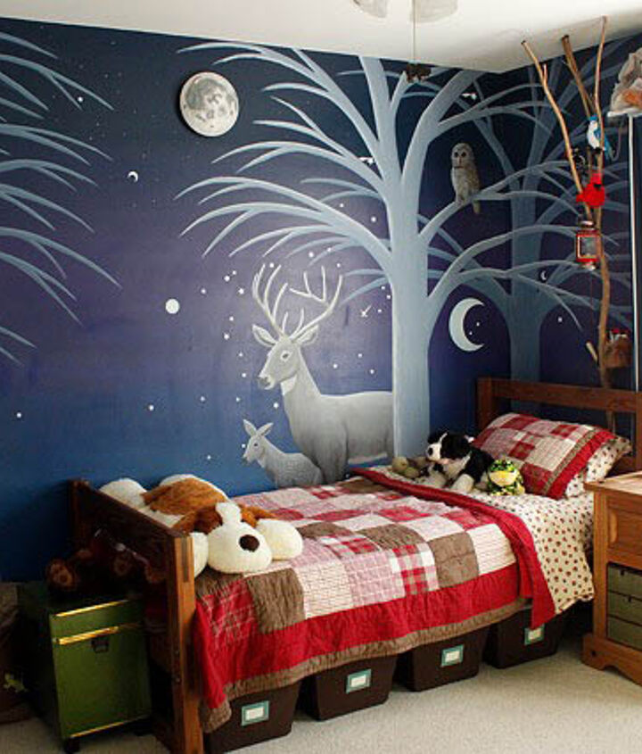 Night side with forest animals illuminated by a light up moon.