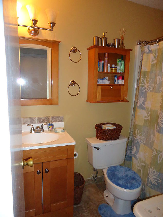 q our duplex remodel in amp out, doors, home decor, kitchen backsplash, kitchen design, tiling, New guest bath with tiled floors but we since changed the faucet to Pfister popup drain system