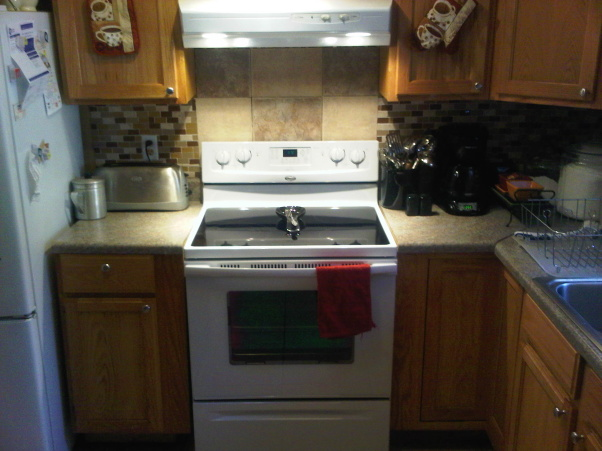 q our duplex remodel in amp out, doors, home decor, kitchen backsplash, kitchen design, tiling, Finally a new cooktop stove