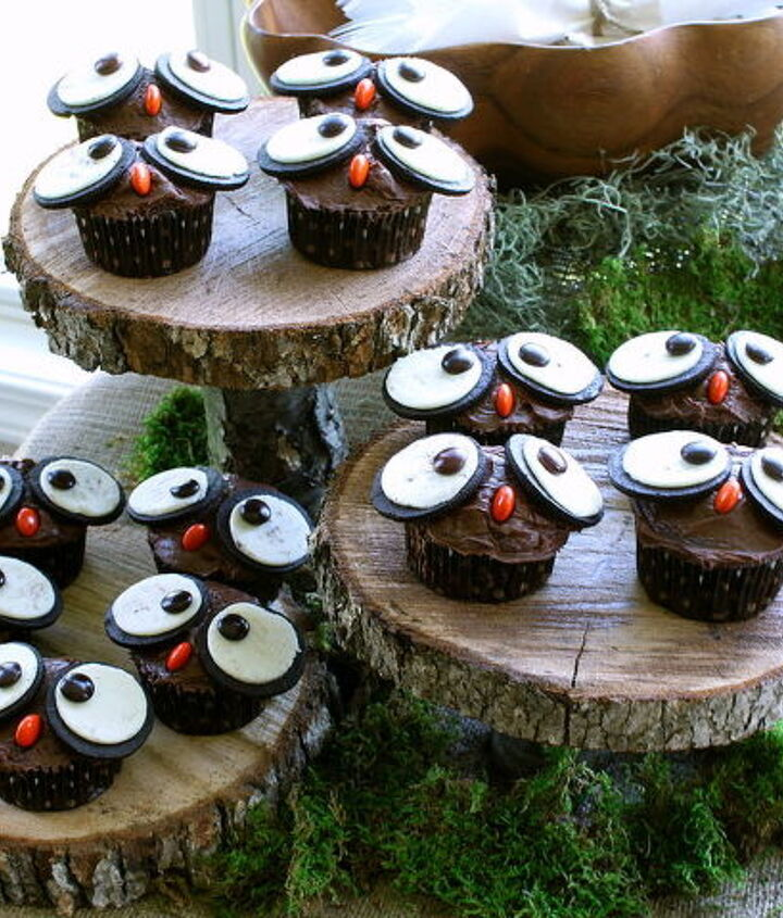 Some owl cupcakes and tree stump platters from our backyard helped the food table. http://justagirlblog.com/woodland-party-part-1/