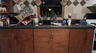 kitchen furniture, painted furniture, repurposing upcycling, Homemade plywood cupboards and an on clearance counter top thanks daddy on the other side of the room dirty dishes too Salvaged tiles on the walls