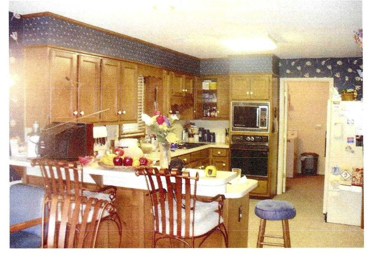 The owners of this kitchen complained that, among other issues with this kitchen, they could not open the oven and the refrigerator at the same time! Clearly this was a kitchen that needed the cabinets REPLACED! http://bit.ly/ODeX8U