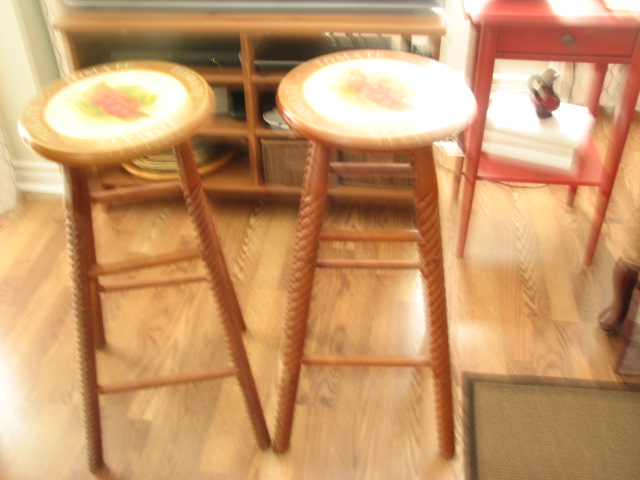 2 stools, stain and painted design on top..