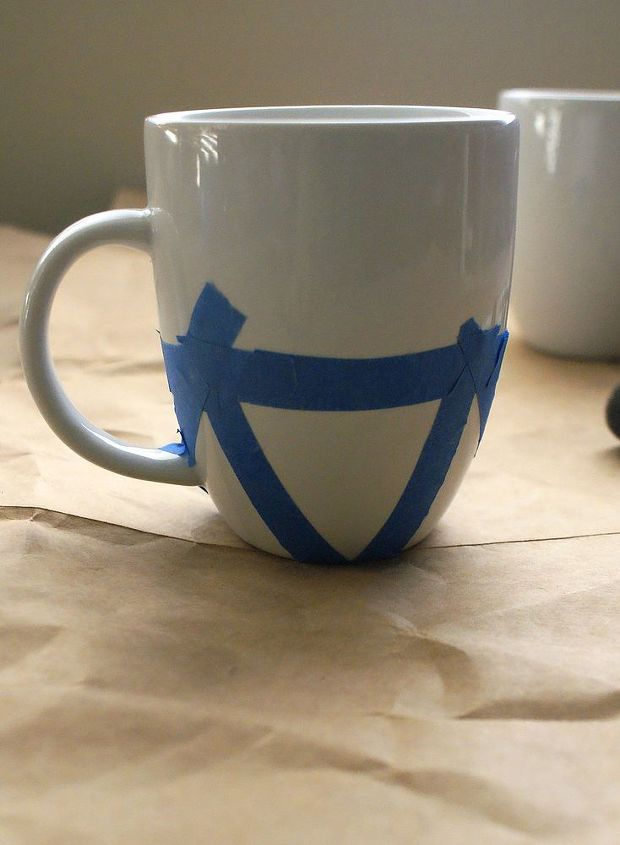 Draw or paint the design on your mug, or tape off shapes using painter's tape.