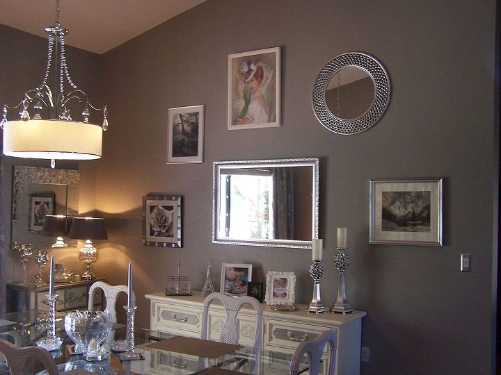 my dining room redo with reused furnishings, dining room ideas, home decor, repurposing upcycling, This is my wall of art and mirrors The Buffet from Craig s list