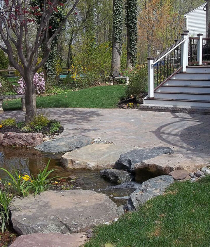 Water features change with the seasons, a patio provides a place to sit to watch the seasons pass from one to the next