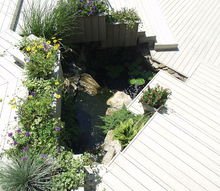 micro pond installed to ceate movement and sound in a former planting bed, decks, gardening, outdoor living, patio, ponds water features, stairs, Trex deck and platform stairs with an Aquascape micro pond in a former planting bed
