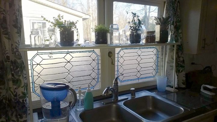 Leaded glass on a budget.  That frosted look is just the contact paper, it is translucent. The lines are thick glittery paint.