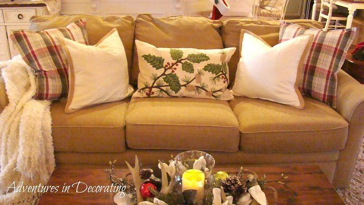 Festive holiday pillows from Pottery Barn fill the sofa.