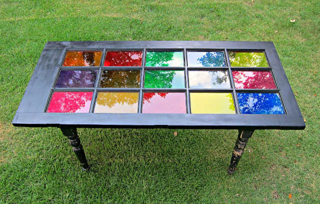 I used DecoArt Glass Stain in multiple colors.  My kids actually painted all the glass!   http://www.morenascorner.com/2013/08/dont-trash-it-how-to-repurpose-table.html