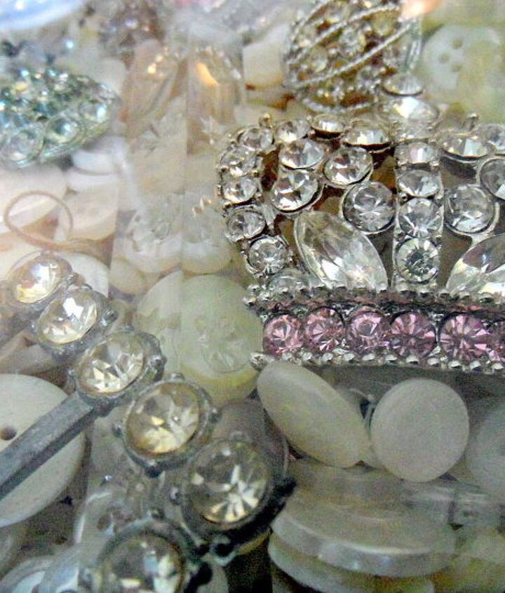 I added my collection of rhinestone brooches, belt buckles, and other jewelry on top. I love them all, and didn't have another way to display them. The crown brooch came from on a Christmas stocking at Target a few years ago.